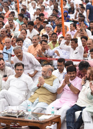 People Listen Prime Minister Narendra Modi's Mann Ki Baat Through Radio At Kakrola Stadium