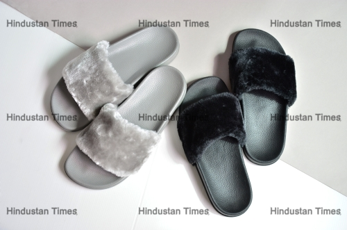Gray,And,Black,Sandals,On,White,Ground,Floor