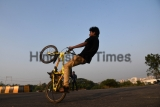 A Boy Doing Stunt On Bike
