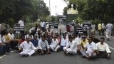Members Of Aam Aadmi Party Protest Against BJP Over Delay In Regularisation Of Unauthorised Colonies In Delhi