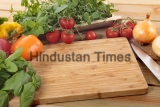 Herbs,And,Vegetables,With,A,Blank,Chopping,Board.,Space,For