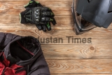 Overhead,View,Of,Biker,Accessories,Placed,On,Rustic,Wooden,Table.
