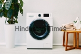 Green,Plant,Near,Washing,Machine,,Wooden,Coffee,Table,With,Towels
