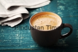Coffee,Mug,With,Newspaper,On,Teal,Rustic,Table,,Cozy,Breakfast,