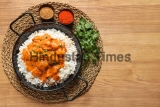 Delicious,Butter,Chicken,With,Rice,In,Dish,On,Wooden,Background,
